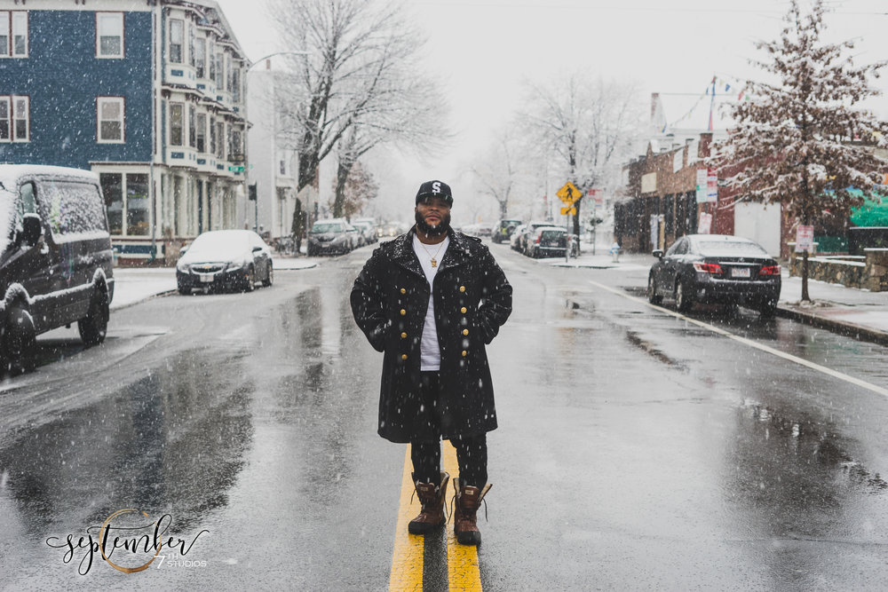 David Cohen photographed on a busy street in his hometown of Cambridge, MA