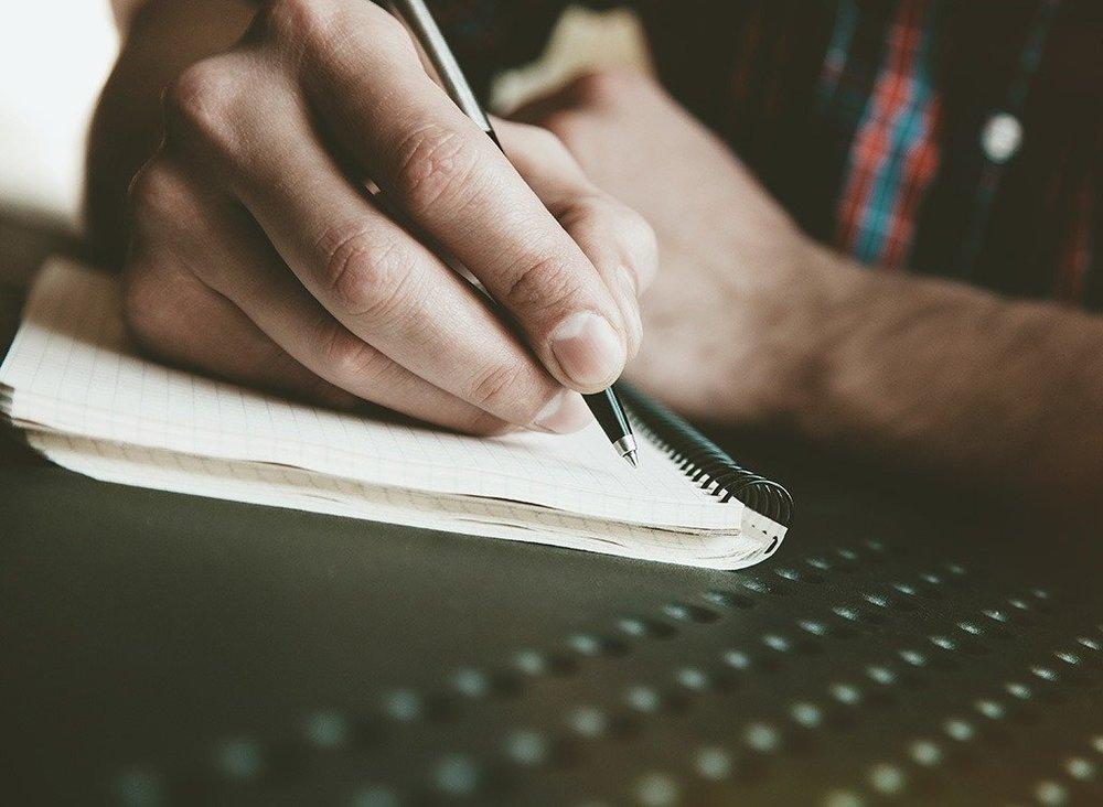 man-writing-in-journal.jpg