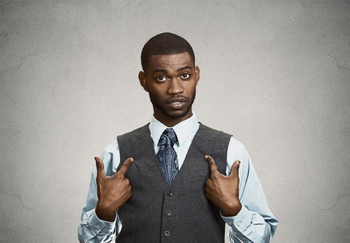Black-man-pointing-at-self.png