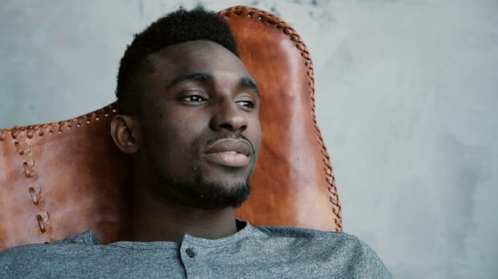 videoblocks-a-young-african-male-sitting-in-the-chair-looking-into-the-distance-and-thinking-about-something-man-looks-thoughtful_rolr2itae_thumbnail-full01.png