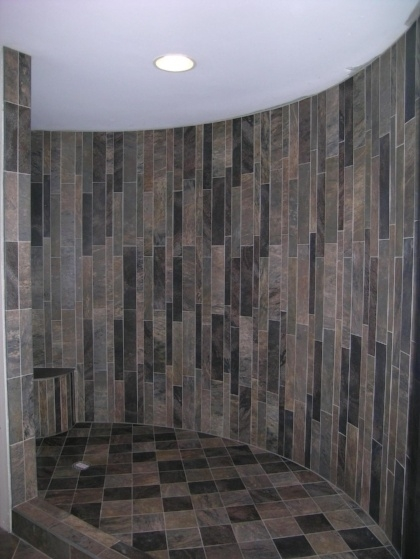 Darker shades create drama. Notice how the small tiles lend themselves to the curve?