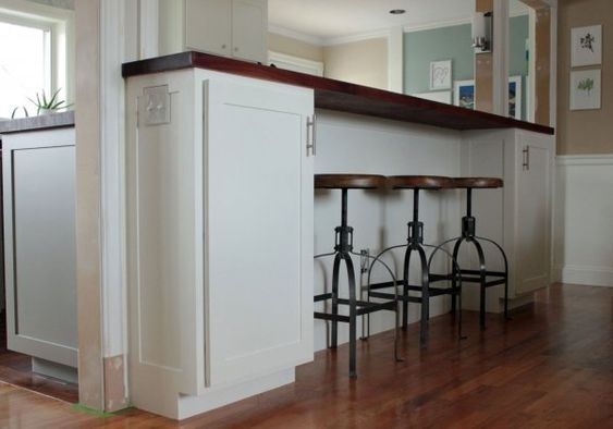 A tall breakfast bar will hide the kitchen mess.