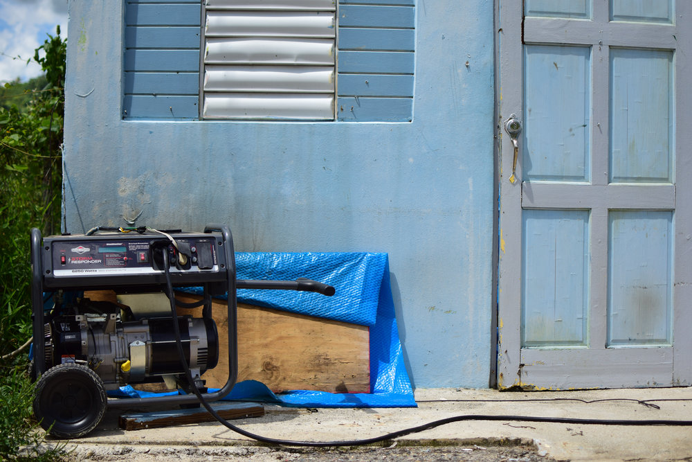 A generator sits outside the door to Wilson Rivera's home in Adjuntas.