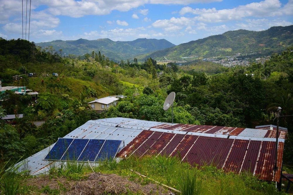 A solar array in the community of El Hoyo, Adjuntas, Puerto Rico.
