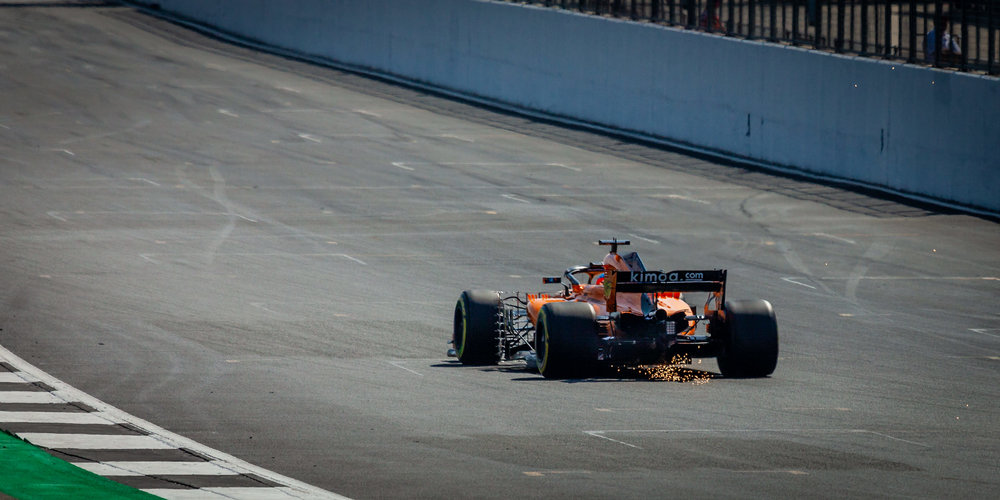 Sparks will fly!! One of the McLaren Renault's bottoming out along the National Pit Straight.