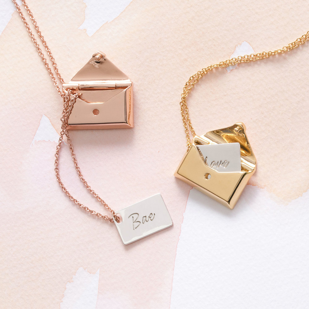 Custom Envelope Locket Necklace: These two-toned envelope locket necklaces come with a pull-out letter inside of an envelope. Customize the letter with a secret word or special date in any unique handwriting. A sweet way to carry your bae with you throughout the season!