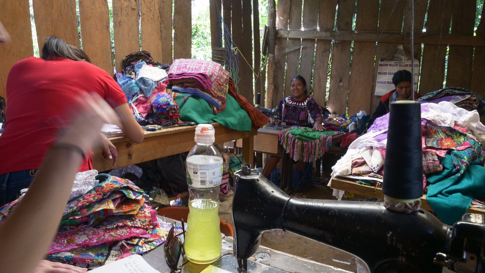 A microfinance nonprofit helped this lady with the set up and initial operating costs to start a garment making business.