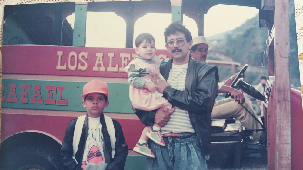Estefania (centre) with her brother and father