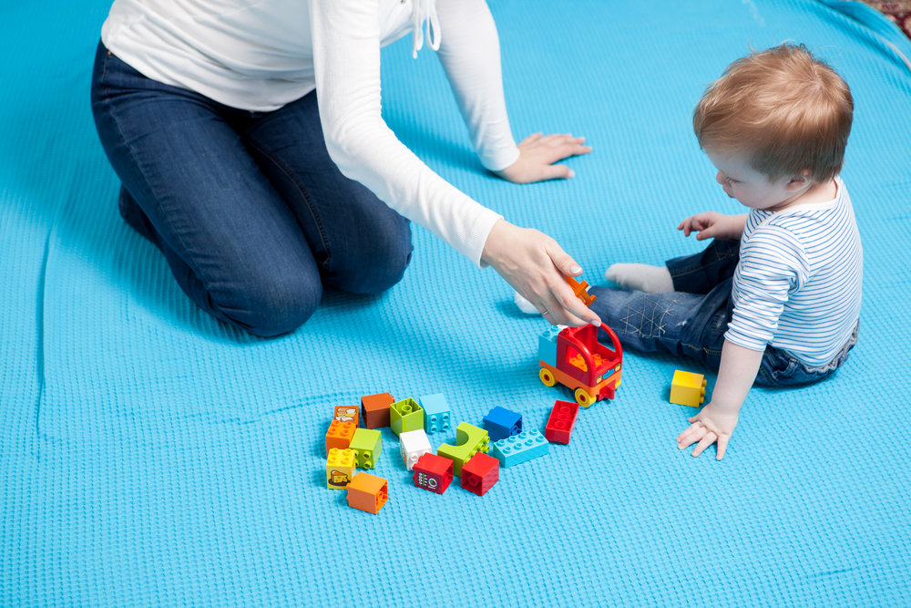 preatty-baby-boy-playing-with-toys-on-the-floor-P27Z9NE.jpg