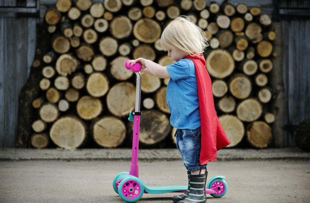 superhero-baby-boy-using-scooter-adorable-concept-PEDVEX4.jpg