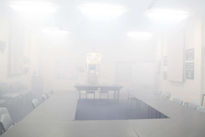 Foggy meeting room  by Anonymous  -  This image serves as an accurate replication of visual haze as seen within a meeting room.
