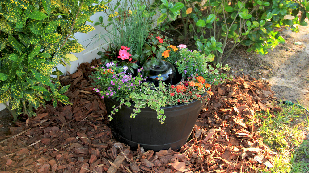 Copy of Whiskey Barrel Fountain with Flowers