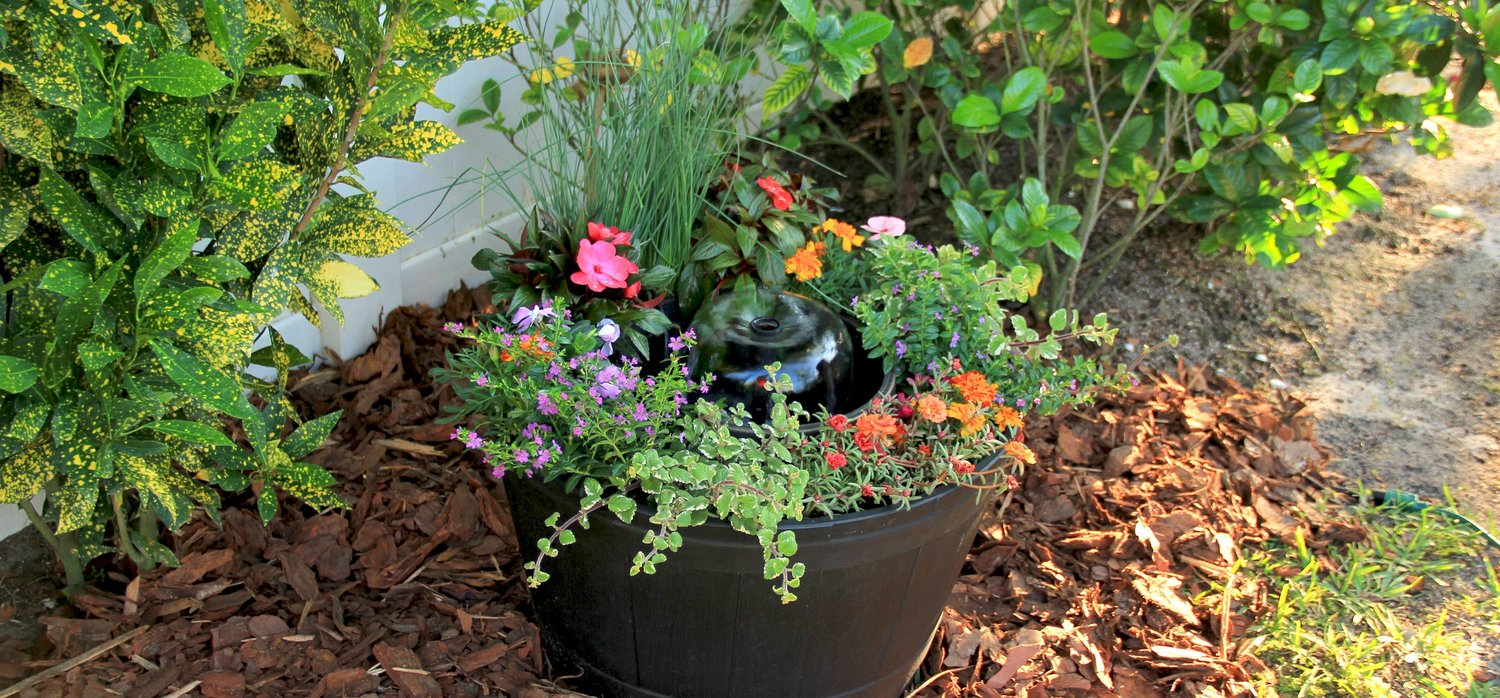 Whiskey Barrel with Flowers — TotalPond