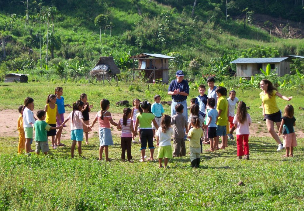 Past president, Larry Cochran, is enjoying a game of tag with some children in Nicaragua.