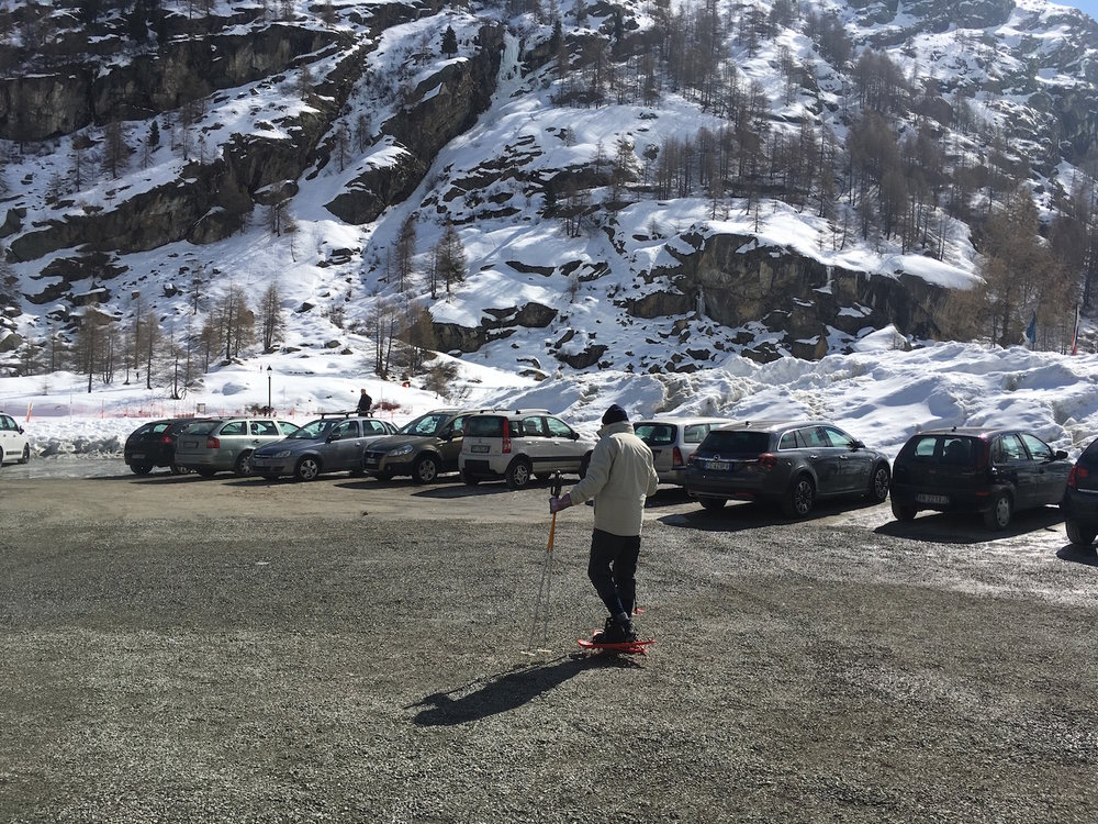 Snowshoeing through a car park in Italy.  Maybe it's a thing? -