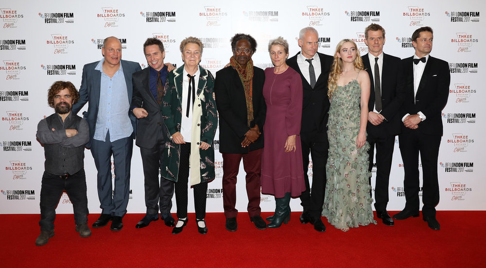 """2. THE CAST OF """"THREE BILLBOARDS OUTSIDE EBBING, MISSOURI"""" -   Abbie Cornish,  Peter Dinklage, Woody Harrelson, Zeljko Ivanek, Frances McDormand, Sandy Martin, Clarke Peters, Sam Rockwell. Lucas Hedges, Caleb Landry Jones (not pictured).    """" I've got American voices in my head. I couldn't say that they're specifically Missouri voices in my head. I know Sam went down and spoke to cops in the state and kind of recorded how they said a lot of the lines in the film. So he kind of tapped into some kind of accuracy about the dialect. But Fran isn't from there, but she's Ohio. And Woody's Texas. So they're all sort of the region, to a degree, or they understand the sensibility. And they're all good actors, too. I mean I traveled around America; I have traveled around America a lot and listened to how people speak generally, or how I think they speak.   (Regarding Sam Rockwell's racist police officer character):  None of these characters are simple heroes and villains, so there's never a point where you're saying he's the hero or he's even decent at the end. But you can say that he is trying to change and where does that leave us? And that's all that the film is kind of doing. It's not saying that he's a good guy now or that this erases all the violence or any of that stuff. And I guess you also kind of question how many people who are racist wouldn't ever call themselves racist, too."""" - director Martin McDonagh, Uproxx, November 7, 2017"""