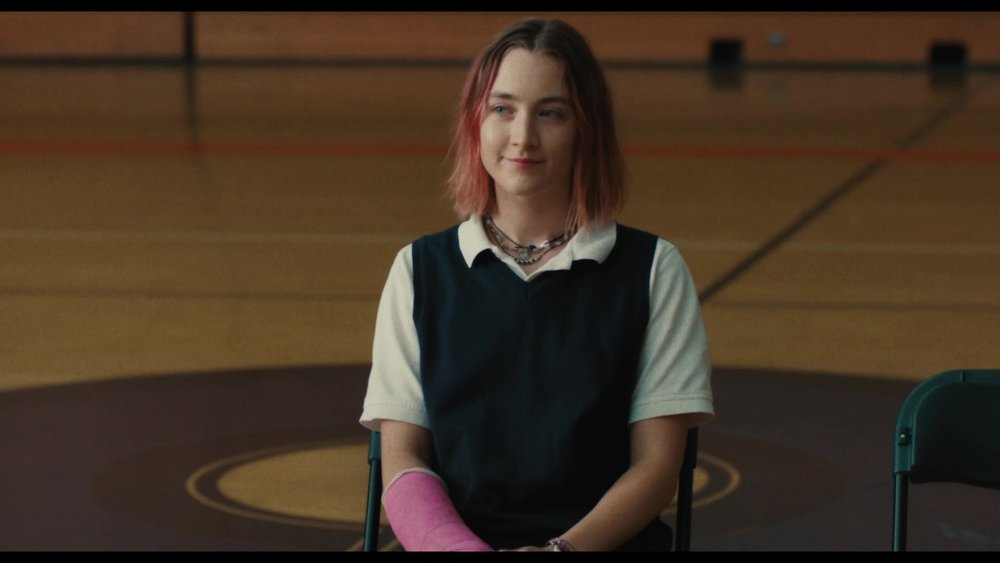 "2. LADY BIRD | Directed by Greta Gerwig | Release Date: November 3, 2017   In Greta Gerwig's brilliant, moving, and hilarious  Lady Bird , Christine ""Lady Bird"" McPherson (Saorise Ronan) is 17 years old and ready to begin her senior year at an expensive private Catholic high school in Sacramento, California. The year is 2002, and the country is still reeling from the 9/11 terrorist attacks from the previous year. The tech bubble has burst and older computer savvy employees have either been downsized, excised, or replaced by cheaper, younger workers. As a country, we are in a bit of a funk here, but life perpetually moves along, no matter what.  Gerwig's film   retains a stunning authenticity about teenage friendships, relationships with parents and the dichotomy of strength and vulnerability that exist within them. When movies and television feature parents and children bickering, oftentimes melodrama is heightened and the reasons behind the arguments appear fantastical in nature. As Lady Bird pinballs her way through a fast-moving senior year, Gerwig places us right in the middle of these moments, allowing us to observe, consider, and reflect. In a way, her camera is also pivoted around on us, aiding us in rekindling our memories from more youthful days, either as the child or the parent caught up in any number of similar situations.   Gerwig crafts just the right words to keep the film from veering off course and feeling disingenuous.    Lady Bird  moved me to tears more than once and speaks volumes about the ""push-away"" and ""pull-close"" relationships children develop with their parents. The film had me laughing early and often - thinking, pondering, and wondering if my college pursuits, and those of my wife, were as stressful on our parents. I also reflected on having a daughter around Lady Bird's age, off to college far away from home. The core of this movie gets so much right, it is as insightful as it is affecting."