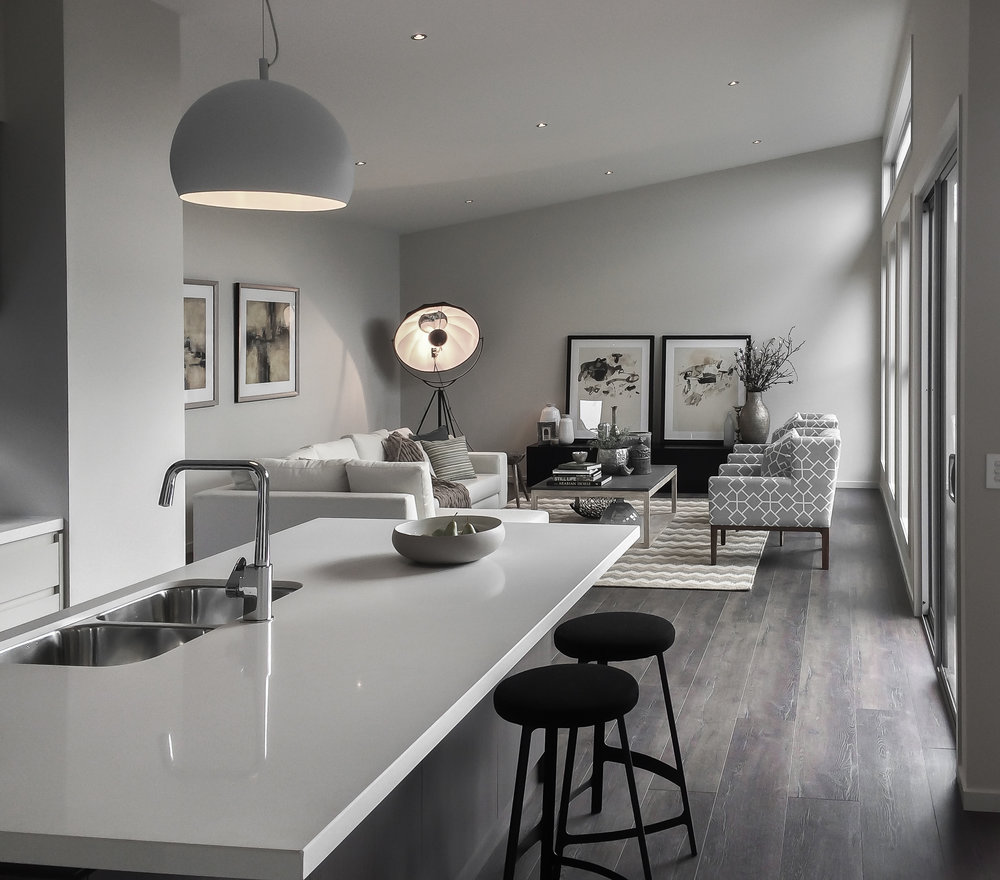 A combined kitchen and lounge room space