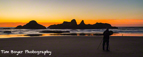 Photographer at Seal Rocks during an October sunset.