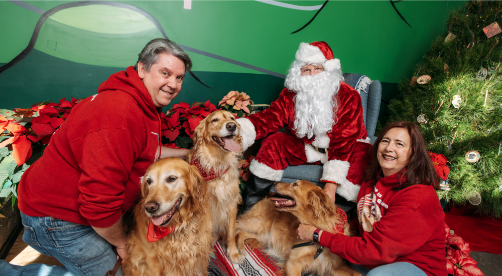 Bella, Woody, & Bebe get their photos taken with Santa and their parents