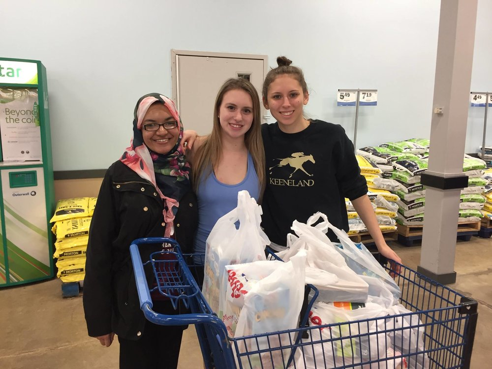 Fahmida, Katie, and Maria getting supplies for an MPower event