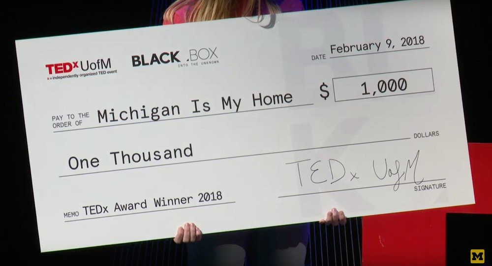 TEDxUofM $1,000 check accepted by Payton Watt and Hussain Ali.