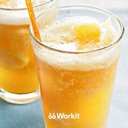 yellow mocktail with fizzy top and a straw