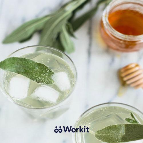 glasses of sage and honey mocktails with sage as garnish