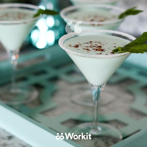 martini glasses with creamy liquid garnish with cocoa powder and mint leaf