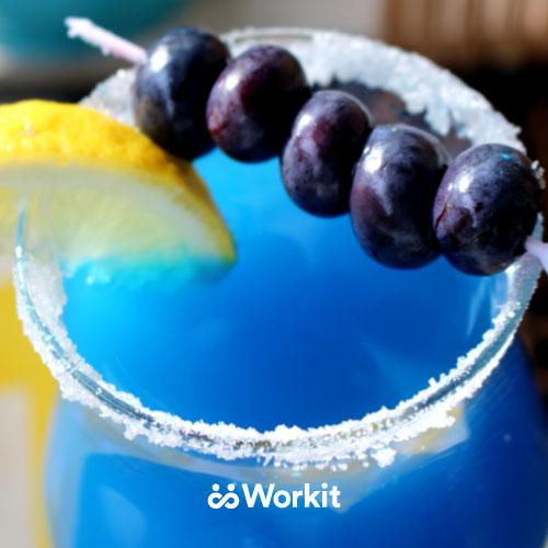 bright blue mocktail with blueberry and lemon garnish
