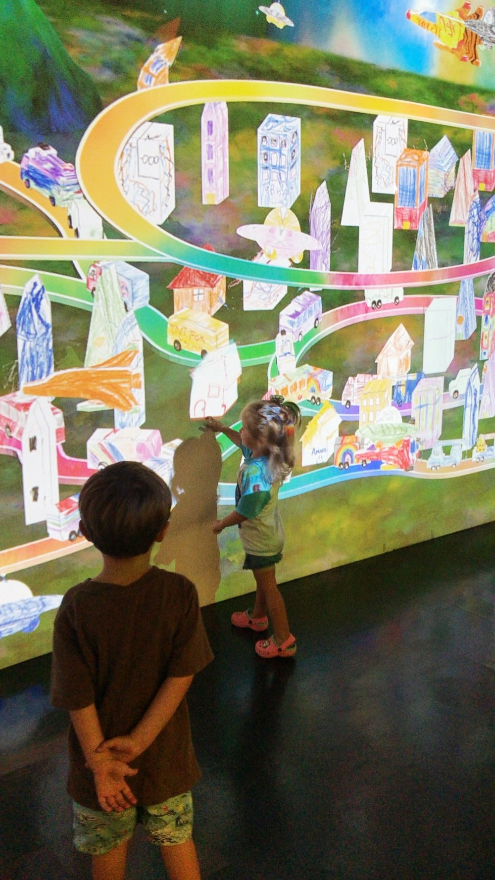 Dream Tomorrow Today a time machine into the future, designing cities, shaping community values, role playing future careers, seeing, doing, imagining and being the future.  This is a summer exhibit for kids in partnership with the San Antonio Texas tricentennial celebreation.