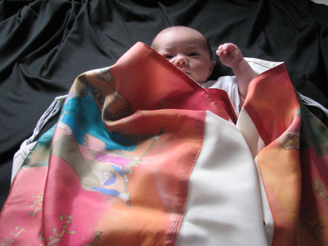 Feedback about the Devarim Tallit - MarilynThe baby naming was great. Everyone loved her tallit.The best part of wrapping her in her tallit was that I got to carry her up to the bima in it. For my alyiah, her tallit touched the torah. I love knowing that this is my first gift to her and that it is one that will be a part of every momentous Jewish occasion of her life. I think that on her wedding day when she wears it under the huppa, it will be incredible to be able to look back at her wearing it at her baby naming and her Bat Mitzvah.Thank you for creating such a wonderful gift for my daughter.Shavuah tov,Felicia