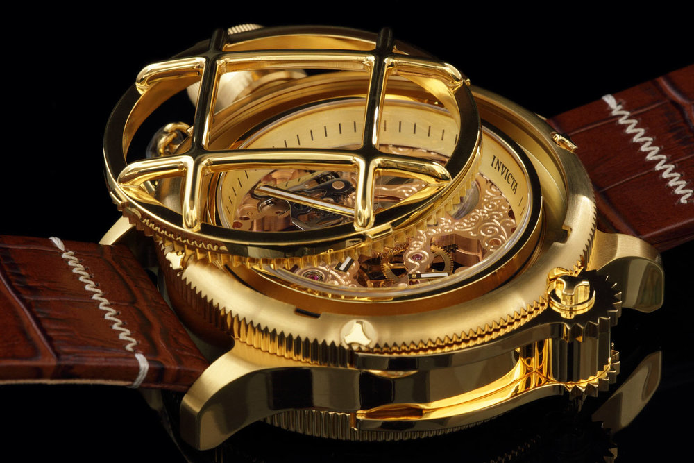You would think that creating a quality photograph of a watch would be dramatically easier than capturing an image of a snowy owl in flight. But when Ken first attempted watch photography, he discovered it was anything but simple. Like a mirror, the polished surfaces of most watches reflect anything near them, including the photographer.  -