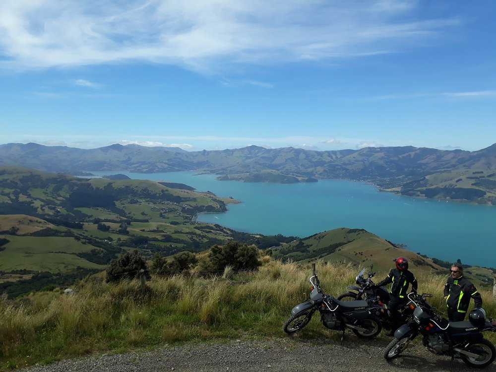 Beatiful azure waters of Akaroa Harbour looking over Wainui from high up Bossu Rd
