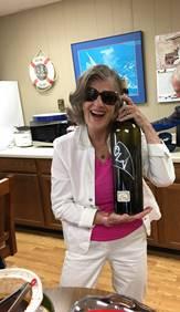 Rachel - With big (empty) wine bottle & empty crockpot.