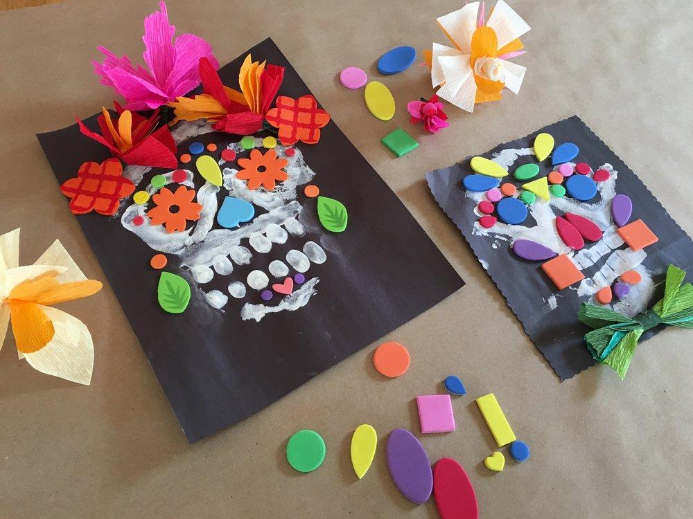 Mixed Media Splendid Sugar Skulls, finger painting, foam shapes, and paper flowers