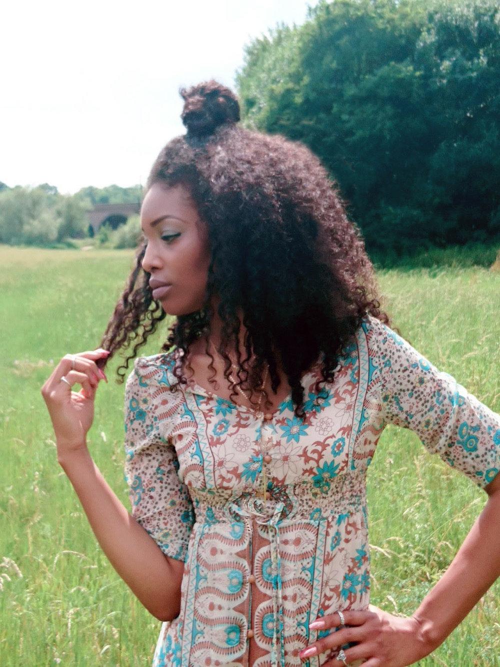 Curly hair, green dress