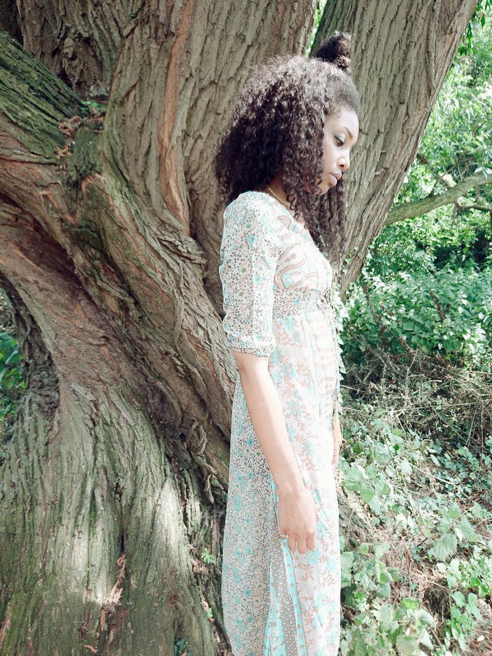 Curly hair, green maxi dress