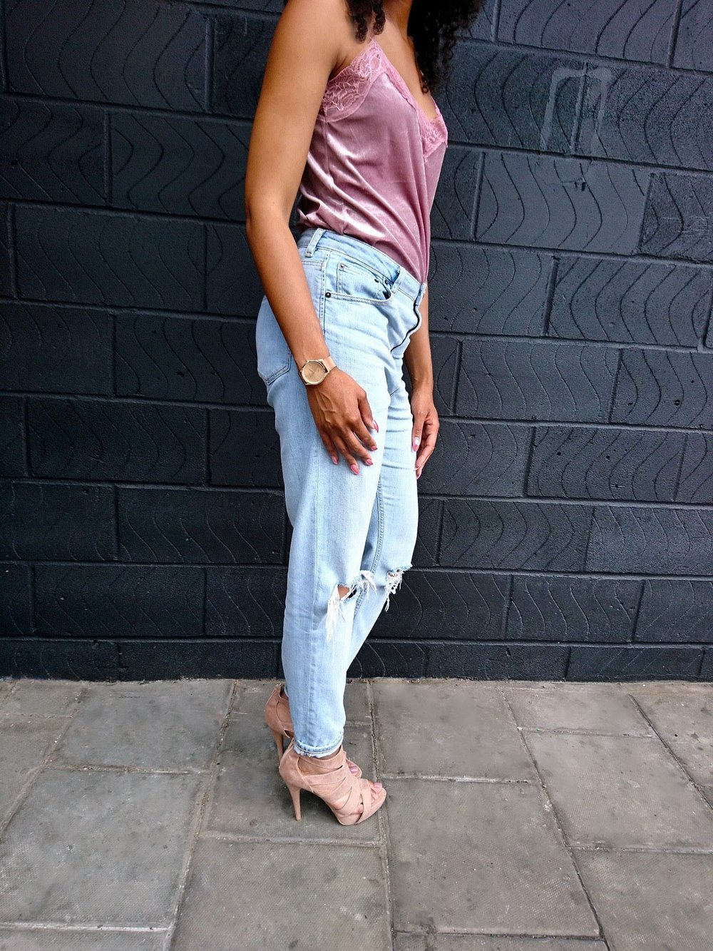 pink camisole stonewash jeans blush shoes curly hair