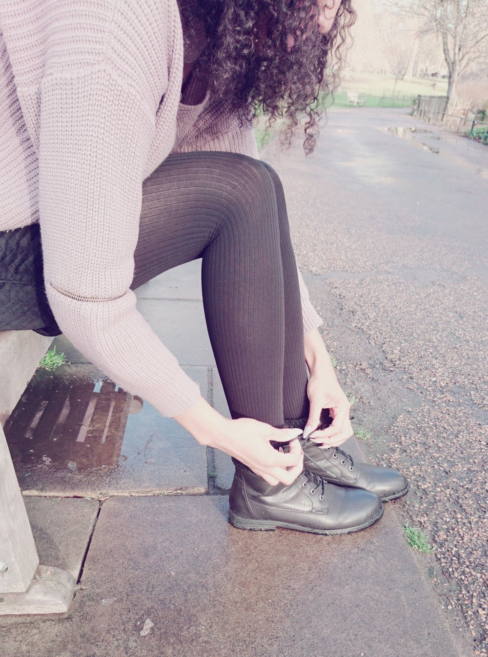 Black mini skirt, black tights and black ankle boots for Winter
