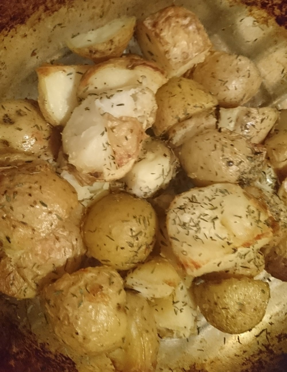 Prep time: 5 mins  Cook time: 70 mins Yield: 4 - 6 servings  Ingredients:  8 White potatoes - medium  2 tbsp Fry Light olive oil spray (or any other low cal oil spray of your choice)  1 tsp Garlic powder  1 tsp Thyme  1 tsp Sea salt  Ground Black pepper to taste    Method:  1. Bring a pot of water to boil. While it is coming to the boil, wash and cut potatoes into 4  2. Place them into the pot and boil for 10 minutes - this will help make these roasties fluffy  3. While potatoes are boiling, preheat oven to 200C and place an oven dish in the oven to heat up  4. Drain the potatoes thoroughly and place into the preheated oven dish  5. Add the oil spray, salt, pepper and thyme. Then stir gently to coat the potatoes  6. Cook for 60 minutes or until crispy, serve and enjoy