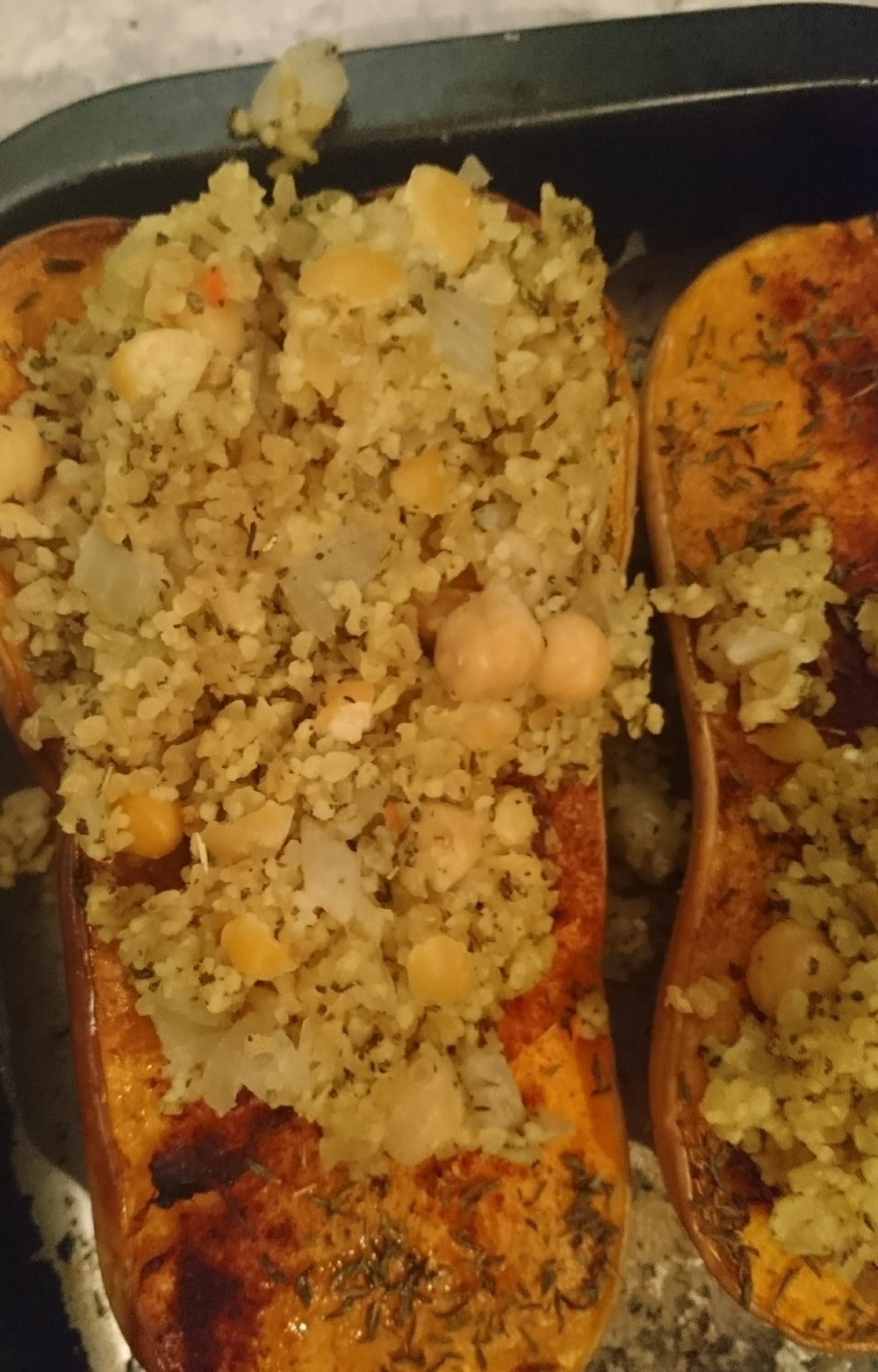 Prep time: 10 minutes  Cook time: 55 minutes  Yield: 2 - 4 servings  Ingredients:  1 Butternut squash  1 tsp Paprika  1 tsp Thyme  1 tbsp Fry Light Olive oil  100g Bulgur wheat cous cous mix  100g Cooked chickpeas  1 White onion  1 tbsp Garlic powder  1 tsp Bouillon or stock powder  1 tbsp Dried sage  Sea salt and pepper     Method:  1. Preheat the oven to 260C  2. Cut the squash in half lengthways and scoop out the seeds  3. Spray the Fry Light and rub the paprika, thyme, sea salt and pepper on the flesh of the squash  4. Place in the oven for 15 - 20  5. Meanwhile spray a saucepan with Fry Light, add to the heat and sautee the onions  6. Add the bulghur wheat and cous cous and sage  7. Mix the bouillon with 50ml boiled water and add to the saucepan  8.  Stir until the bulghur wheat and cous cous has absorbed all the liquid  9. Add in the chickpeas and cook for 2 minutes then squash the chickpeas  10. Remove the squash from the oven and stuff with the mix  11. Put the squash back in the oven for 15 minutes - if you have any extra stuffing place this into an ovenproof dish and cook this along with the squash  Serve and enjoy