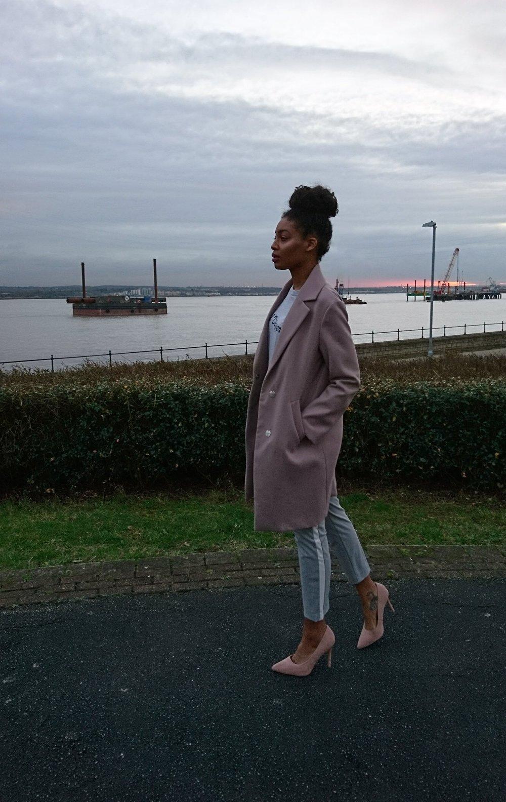 Goal Digger T-shirt - Topshop    Lilac coat, blush shoes and black bag - New Look    Grey trousers - Zara