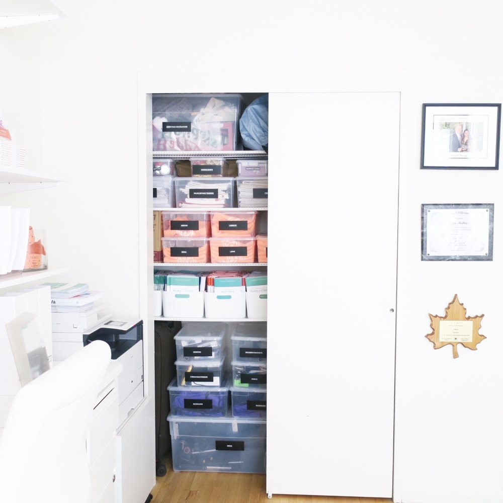 HIDE BULK BEHIND CLOSED DOORS - Inside the closet I brought in my favorite plastic bins that come in multiple shapes and sizes and are extremely affordable. No matter the size or shape you use, they stack nicely and look clean and streamlined. The bins hold extra t-shirts, less frequently used products and…more books!