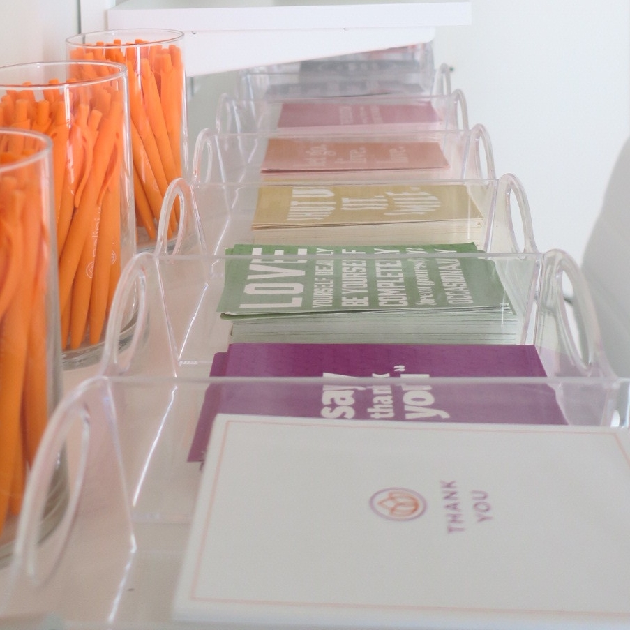 """ORGANIZE TO DECORATE - I found these postcards all mixed together in a cardboard box so I dumped them out, organized by color and gave each one a home in the adorable clear trays. I love how the post cards are all different colors because it helped decorate the space. Sing with me now…""""can you paint with all the colors of the wind?"""" Just call me Pocahontas."""