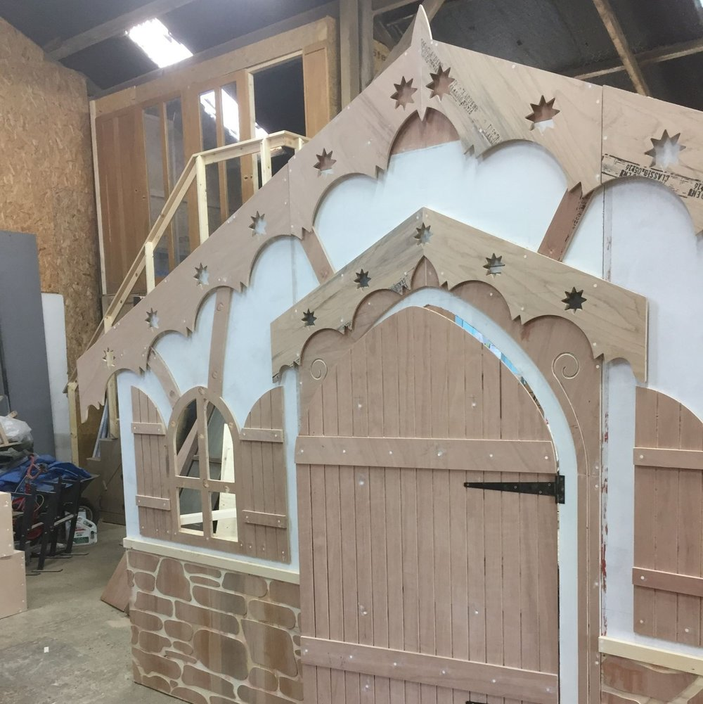 Christmas Lodge  - All the elements of this facade were cut on our CNC router. It breaks into three pieces for storage and travel. The Christmas Lodge was painted by the client and used in a Christmas promenade interactive performance.