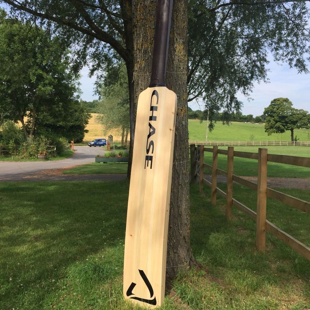 Big Cricket Bat - After gluing planned pieces of joinery grade redwood together we machined the bat in two halves, the face and the back of the bat. The halves were then glued together and finished by hand. The bat was used for promotion.
