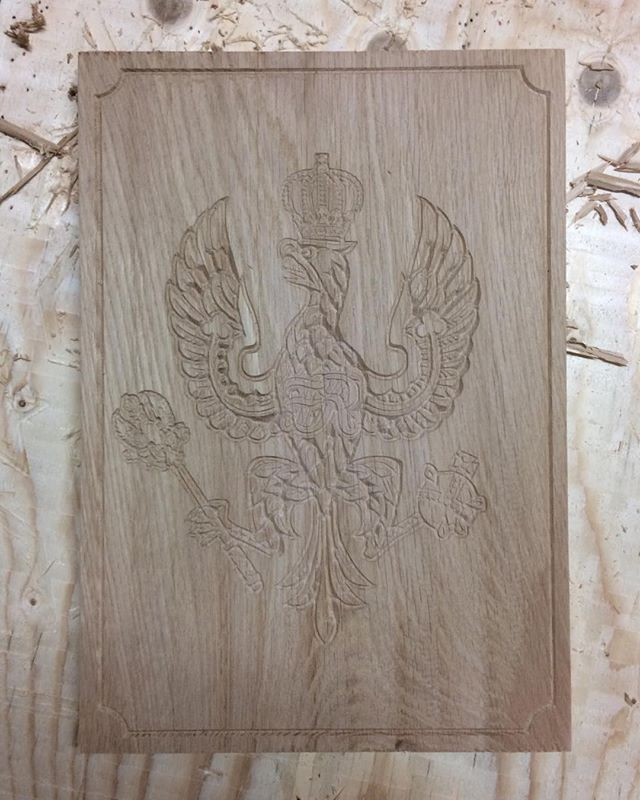 Engraving a military crest into an oak board for a client. #crest #eagle #military #cnc #cncrouter #tinshed #tinshedscenery #oakboard #carving #engraving