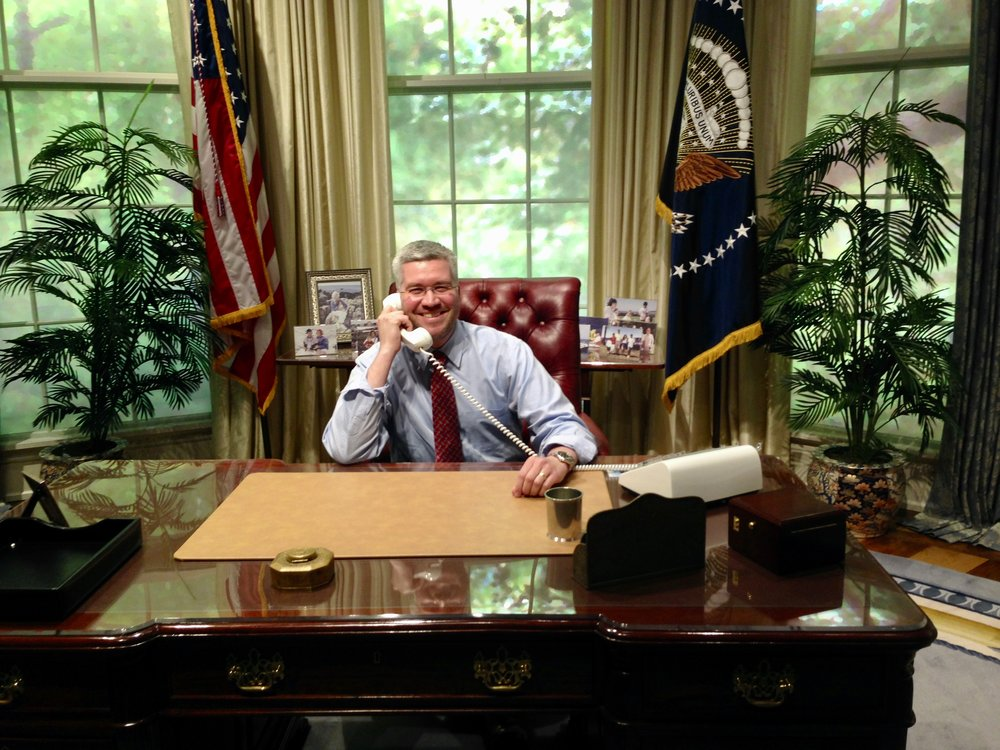 Making an important call at the replica Oval Office in College Station, TX, 2014.