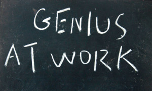 genius at work title written with chalk on blackboard